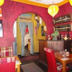 Moroccan-Middle Eastern Lamps, Paintings, Swords, and Carpets in Dining Room