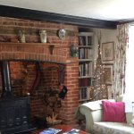 Guest lounge with inglenook fireplace