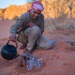 bedouin eat in the desert of wadi rum at sunrise