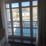 French balcony door open to beautiful view of the marina and mall area