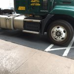 Big trucks park tandem and block disability ramps - parking lot spaces are marked for this parki