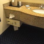 In room safe. Nice feature. Faucets too far back for wheelchair rider's use.