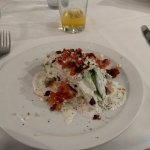 Wedge salad with crispy bacon and house made Bleu Cheese