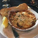 The seafood appetizer, stuffed chicken, veal, creme brule