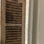 Vent on floor of bathroom - rusted and filthy