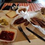 BBQ sausage, pulled pork, moist brisket, pickles, and bread.
