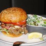 Delicious huge hamburger and salad