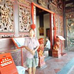 Just outside the entrance to the temple building (with two of the red lion statues behind me)
