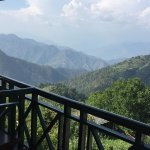 view from room but clouds hide the himalayan range.(banderpunch peak can be seen from here)