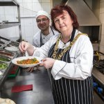 Lord provost Sadie Docherty adds finishing touches to her curry at KoolBa