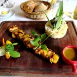 chicken and pineapple skewer with pilau rice and curry sauce