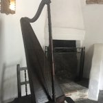 a harp next to the fire place
