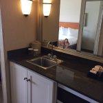 Bar sink, micro, fridge, coffee maker area
