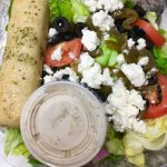 Greek salad and veggie pizza