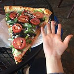At Rosie's, I created my own slice of pizza and it was gigantic! (and yummy!) :)