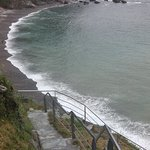 The steep cliff walk down to the pebbled beach.