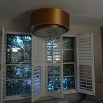 Off-kilter light fixture blocks shutters from opening fully