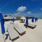 Beach with white sand and massage hut 3-min walk away!