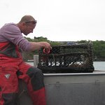 Andy resets a lobster pot