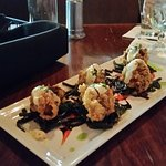Chicken fried oysters on spinach noodles