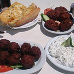 Garlic bread, courgette croquettes, meatballs and tzasiki