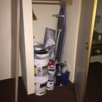 Paint cans and equipment in closet