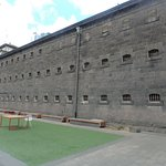 Hanging grounds beside a prison wall.