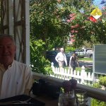 Beautiful outdoor dining on the porch at Zees Grill at the Shaw Hotel and Spa.