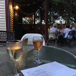A glass of wine on the backyard patio.