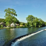 Newby Bridge weir looking over to holiday cottages
