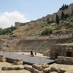 The stage, seating and Alcazaba walls behind