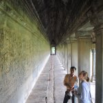 Sophal explaining the context of this large stone carving in Angkor Wat