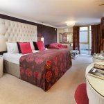The bedroom with superking bed, dressing table and surround sound music system