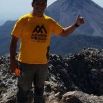 At the summit of Nevado de Colima with the most active volcano in Mexico at the background,