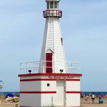 small lighthouse at beachfront