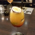 a cocktail with passionfruit. It was delicoius