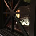 View from the private dining area to the main seating area.