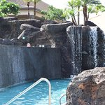 Water falling from the infinity pool and a waterfall covering the slide.
