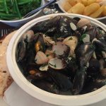 Steamed cockles and Roaring Bay mussels with Clogherhead crab, brown shrimp mayo toast and chips