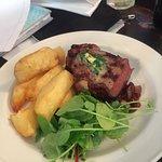 Char grilled 28 day dry-age Irish beef striploin steak with sticky onions, roasted garlic truffl