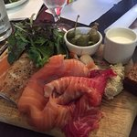 Smoked fish plate with our Dillisk bread, crème fraîche, pickled cucumbers and caper-berries