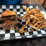small brisket sandwich with a regular order of fries