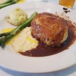 Beef Wellington with asparagus and mashed potatoes.