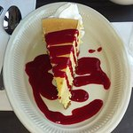 Ginger Mango Cheesecake, garnished with raspberry sauce