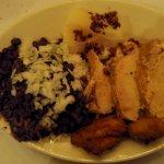 Roast Pork a la Cubana, yuca, fried plantains, black beans, rice