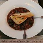 Garlic Snails with Chorizo, Sweet Wine & Grits