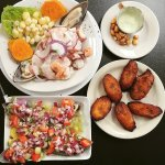 Chilled mussels with onions, tomatoes, and Peruvian corn, seafood ceviche, and fried plantains
