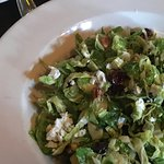 Seasonal sales, shaved Brussels sprouts with pecans, cranberries and crumbled cheese.