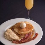 Pancakes, smoked Ghouda grits and Applewood smoked bacon