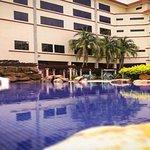 Beautiful view of Swiss Inn Sg Petani swimming pools and children slides